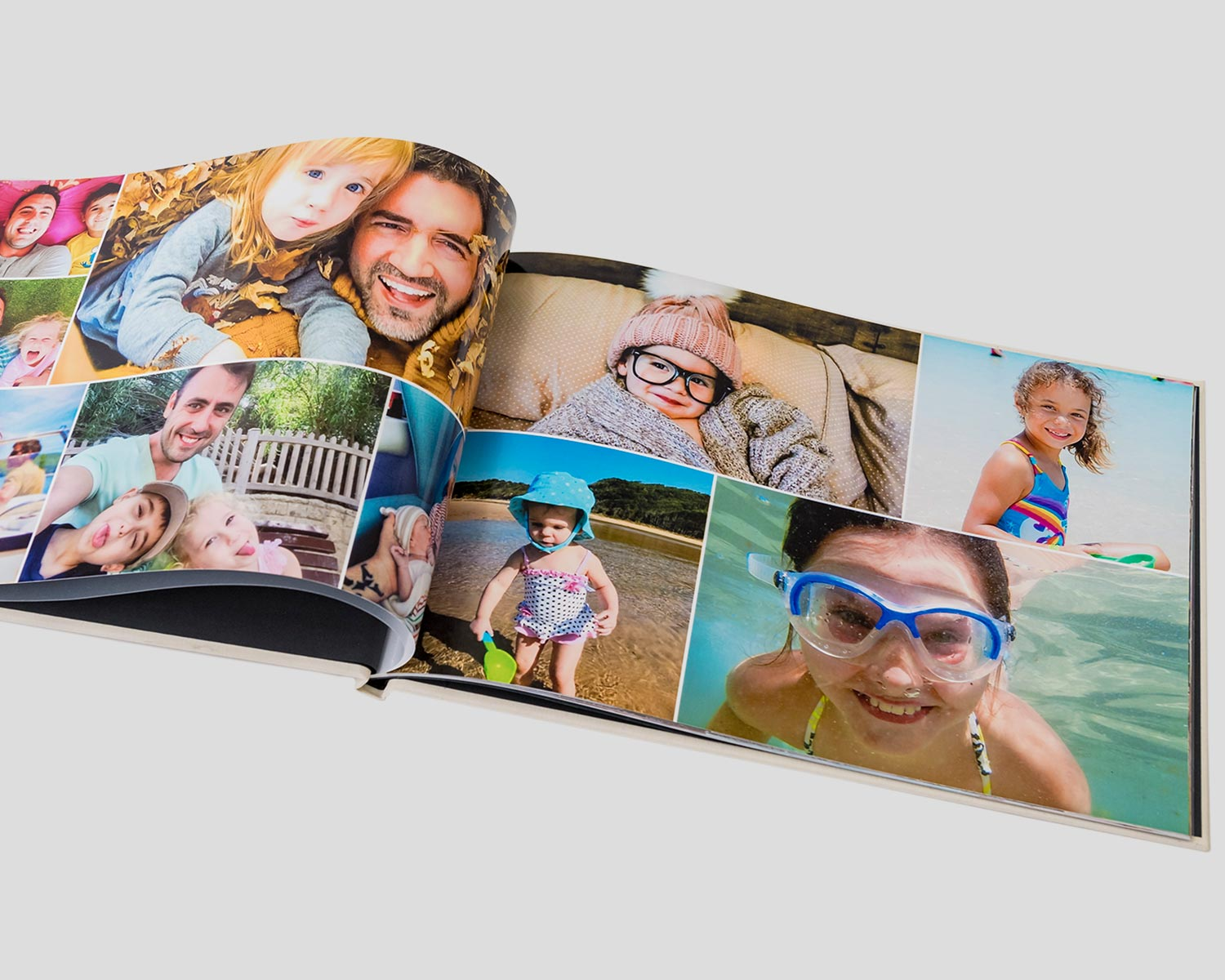 Opened personalised photo book with family photos on display